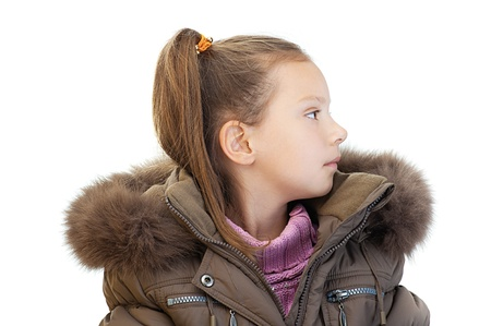 greatcoat: Beautiful little girl profile in warm winter jacket and pink sweater, isolated on white background.