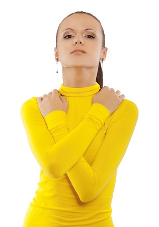 Portrait of young beautiful woman in yellow turtleneck, isolated on white background. photo