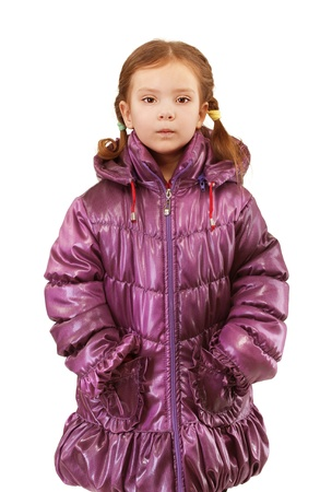 orchestration: Beautiful little girl in warm winter jacket, isolated on white background.