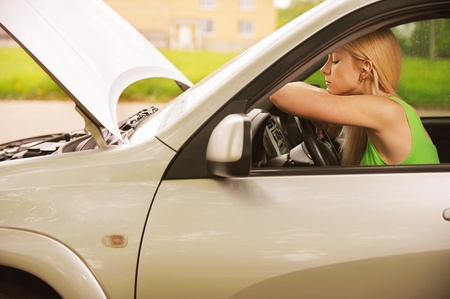 Portrait of sad beautiful young woman in car. photo