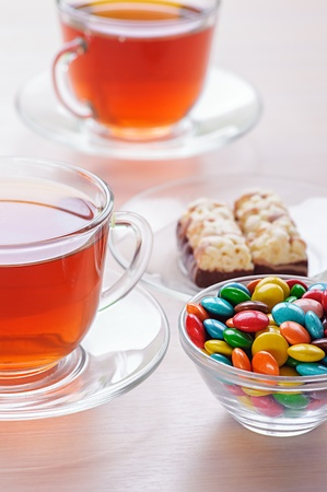 viands: Two cups of tea and iced chocolates on table. Stock Photo