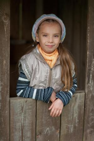 Happy girl-preschooler in wooden hut in children's spring city park. Stock Photo - 14521724