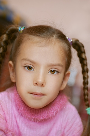 Girl-preschooler in pink sweater close-up Stock Photo - 14521836