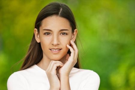 Beautiful teenage girl, against green of summer park. Stock Photo - 14521795
