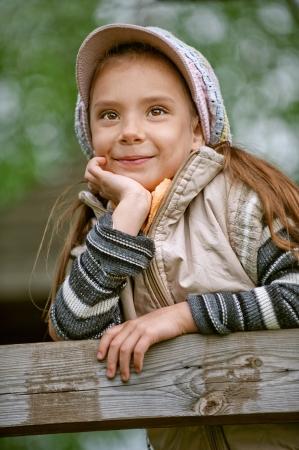 Happy girl-preschooler on green grass in spring city park. Stock Photo - 14521907