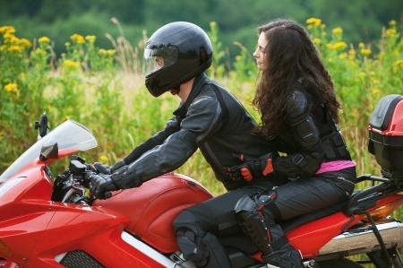 biker girl: Young couple on beautiful bike on road.