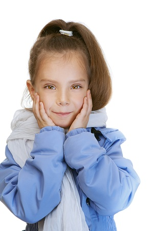suddenness: Girl-preschooler in blue jacket, his hands clasped cheeks, isolated on white background. Stock Photo