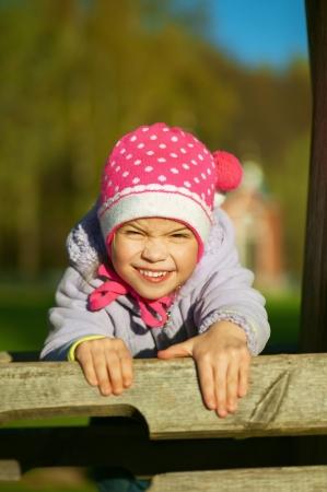 Happy girl-preschooler laughs and plays in city children's park. Stock Photo - 14717244