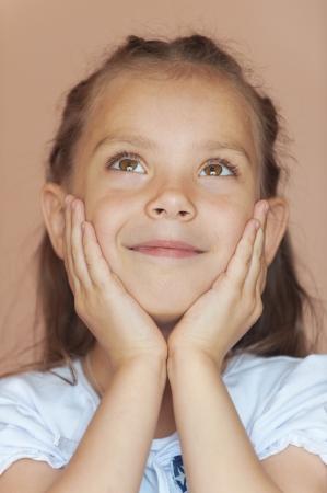Happy girl-preschooler close-up. Stock Photo - 14942979