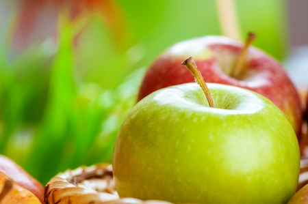 Red and green apple in basket close up  Stock Photo - 16457098