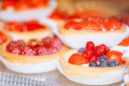 Tartlets with berries  blueberries, raspberries, red currants and strawberries  photo