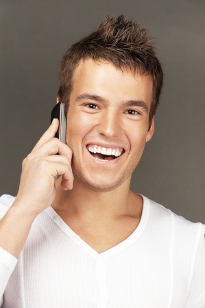 Young handsome man calls by mobile telephone. photo