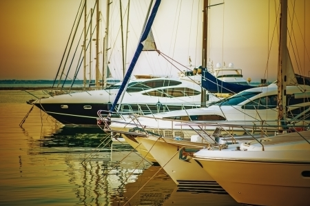 Yachts parked on mooring, in evening sunset. photo