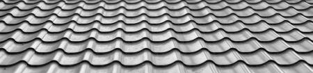 house siding: Background of wavy metallic gray tiles for roofing. Stock Photo