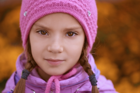 tresses: Close-up portrait of beautiful little girl in pink hat and jacket