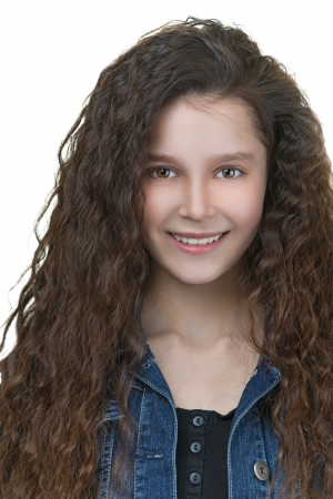 life jackets: Portrait of beautiful smiling schoolgirl with dark curly hair, isolated on white background.