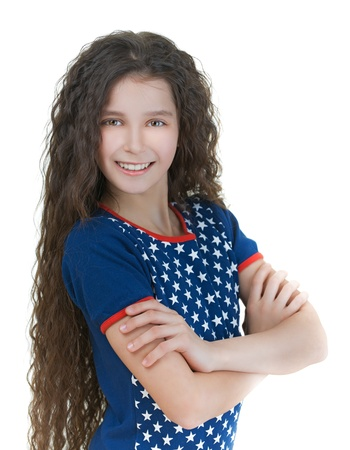 frizz: Portrait of beautiful smiling schoolgirl with dark curly hair, isolated on white background.