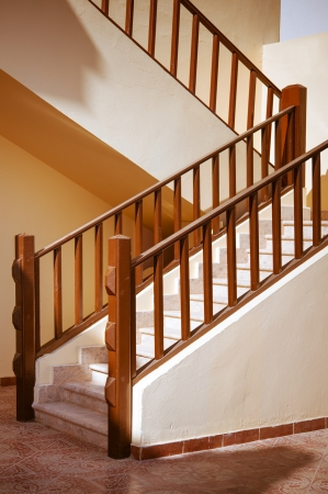 banister: Beautiful stone staircase with wooden banister. Stock Photo