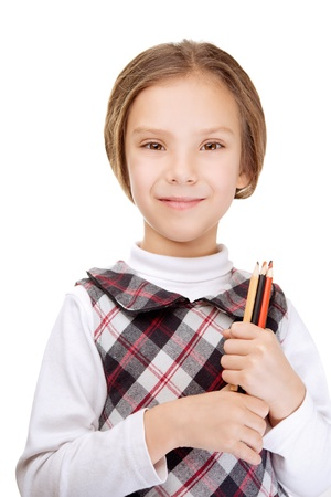Portrait of beautiful smiling little girl with pencils, isolated on white background. photo