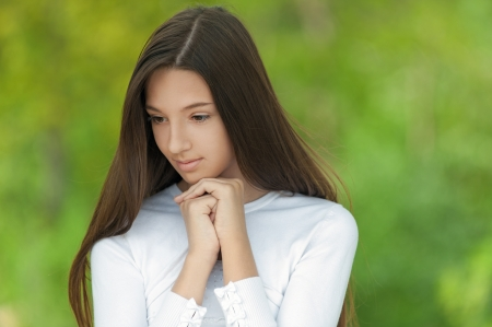 Beautiful teenage girl, against green of summer park. Stock Photo - 19536791