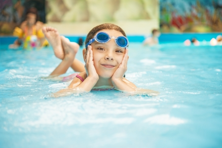 Beautiful little girl in pool water park. Stock Photo