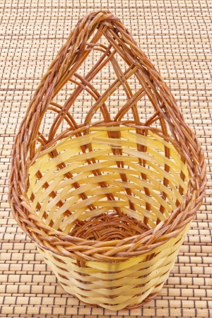 Wicker basket on brown background. photo