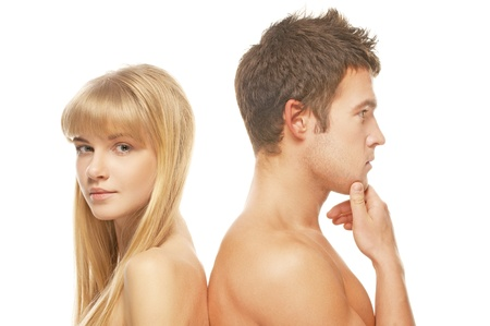 Two young people: beautiful blonde woman and handsome brunette man against white background. photo
