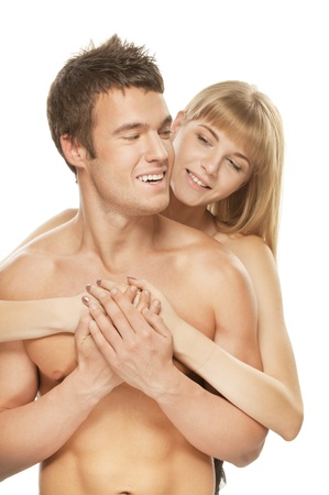 Young happy couple: brunette laughing man and smiling blonde woman against white background. photo