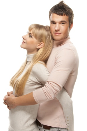 respondent: Two young people: smiling blonde woman and dark-haired man embracing against white background.