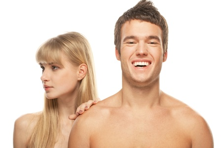 Young happy couple: brunette laughing man and blonde woman against white background. photo