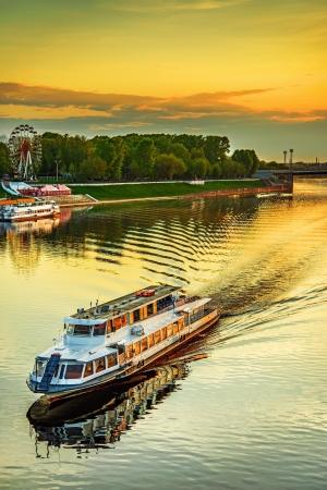 the volga river: Motor ship at sunset sails on river Volga in Tver, Russia. Stock Photo