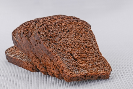 Whole-grain rye bread, cut into slices. photo