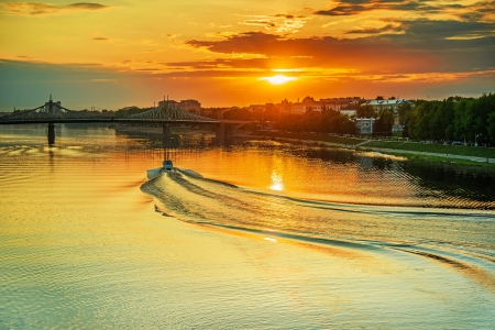 berth: Motor ship at sunset sails on river Volga in Tver, Russia. Stock Photo