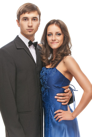 Young beautiful elegant couple - man in suit and bow tie with woman in blue dress. photo