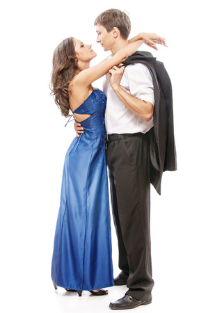hair bow: Young beautiful elegant couple - man in suit with woman in blue dress.
