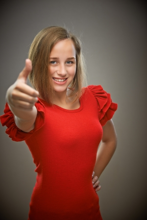 expression portrait of young beautiful brunette woman showing approving gesture photo