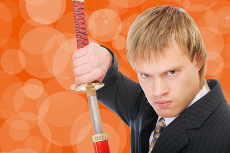 Man with sword protects business, on orange background. photo