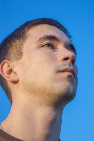 Portrait of young man on large sky background. photo