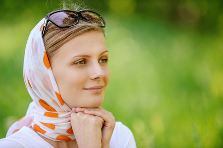 headscarf: Young attractive woman in headscarf with sunshades