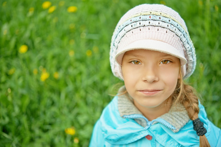 Portrait of pretty little girl in blue jacket in autumn park. Stock Photo - 29086717