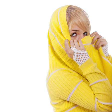 hides: Woman hides face behind yellow yashmak, isolated on white background.