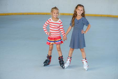 ice skating: Little beautiful girl ice skating at stadium. Stock Photo