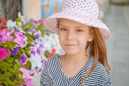 Portrait of beautiful smiling little girl in summer city park. Stock Photo - 29811596
