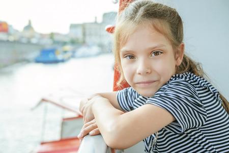 Happy girl-preschooler sitting on bench in city park. Stock Photo - 29811600