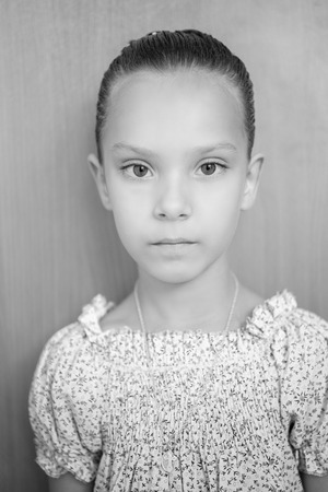 Portrait of beautiful little girl on gray background. Stock Photo - 29989512