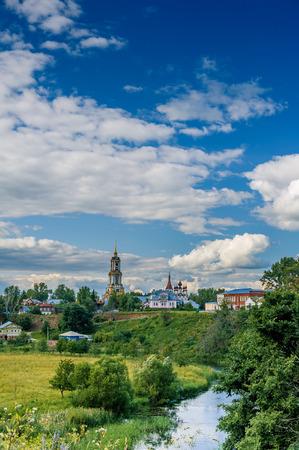 venerable: Venerable Monastery belfry Rizopolozhensky in Suzdal, in bend of Kamenka River Stock Photo