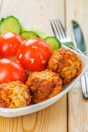 viands: Meat cutlets with cucumber and mushrooms in a bowl on dining table. Stock Photo