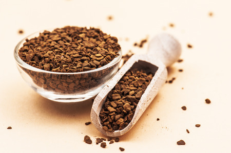 Instant coffee in scoop on table. photo