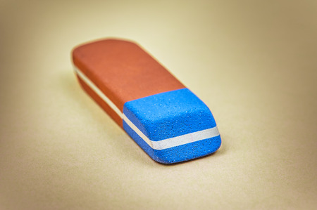 An eraser or rubber is an article of stationery that is used for removing pencil markings. photo