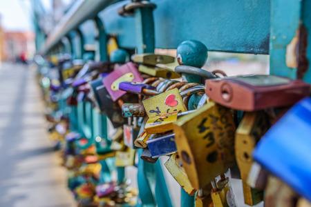locks: Locks on railing of bridge, which hang brides and grooms.
